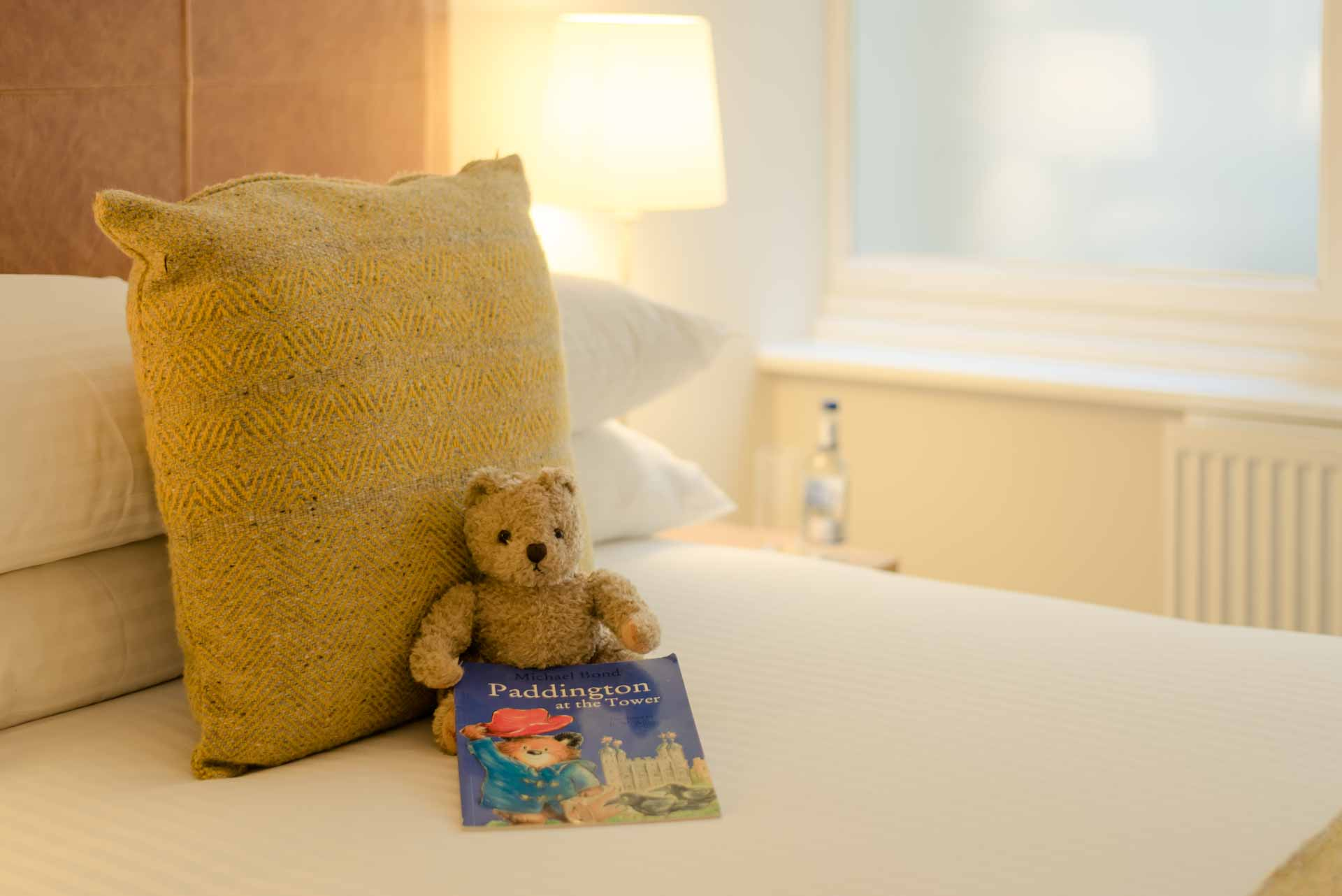 Bed with child's teddy bear and book PREMIER SUITES PLUS Glasgow George Square
