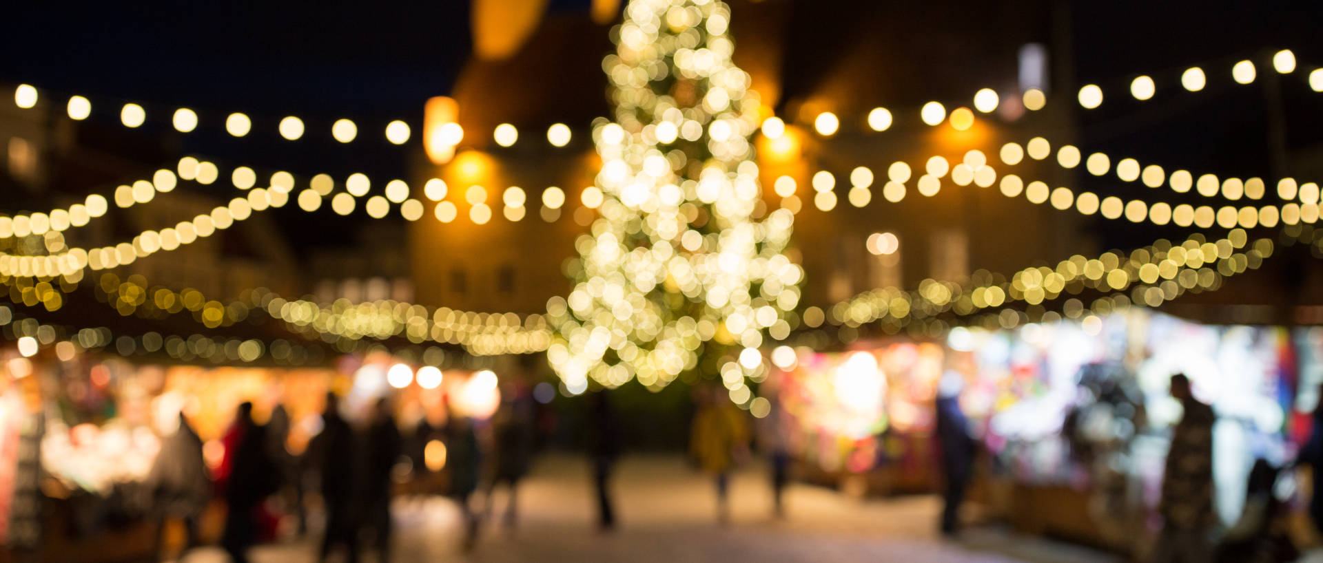 Christmas markets with blurred fairly lights